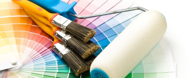 Brushes and paint-roller on a colour guide